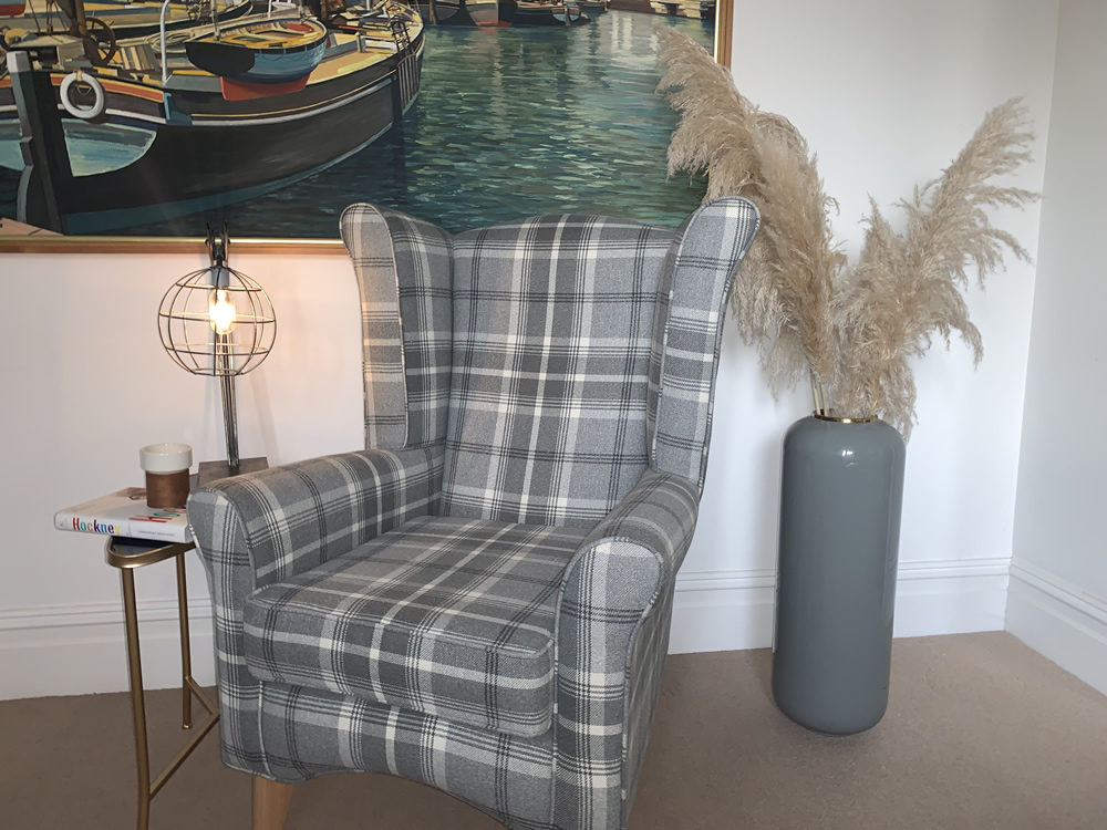 grey check high backed chair